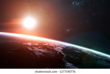Sunrise over the Earth Planet. Science fiction art. Elements of this image furnished by NASA