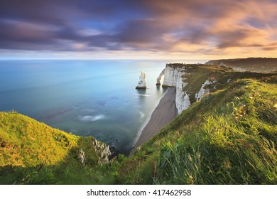 Sunrise over the Falaise d'Amont cliff of Etretat in Normandy, France