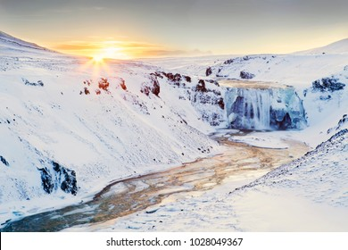 Sunrise over frozen waterfall in Iceland. Taken on the games of thrones location tour.