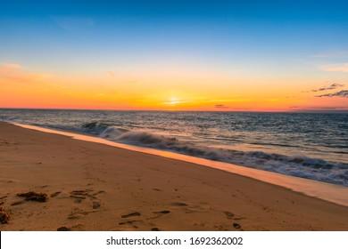 Sunrise over gentle surf on Nantucket Beach