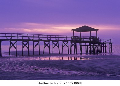 Sunrise over the Gulf of Mexico with pier in Biloxi, MS