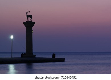 sunrise over the harbor of Rhodes town, Rhodes island, Greece