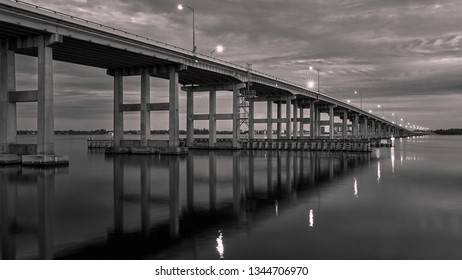 Sunrise over the highway 41 bridge that goes over Caloosahatchee River from downtown Fort Myers Florida