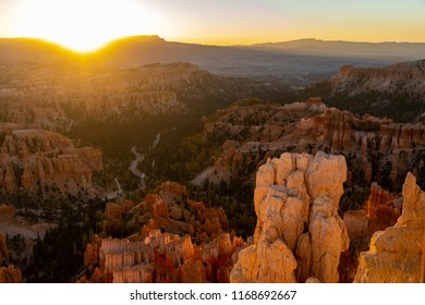 Sunrise over the hoodoos at Bryce Canyon National Park in the summer. Sun on upper left corner of photo, extra copy space