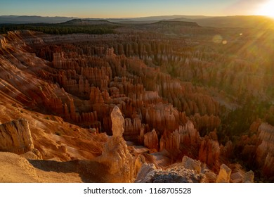 Sunrise over the hoodoos at Bryce Canyon National Park in the summer. Sun on upper right of photo, extra copy space