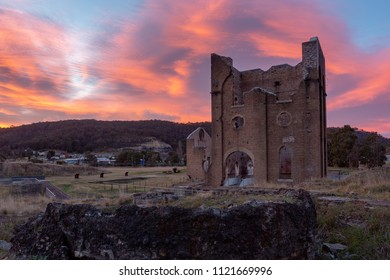 A sunrise over the iconic Lithgow Ironworks blast furnace in the blue mountains of New South Wales Australia on 13th June 2018