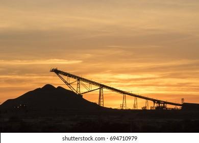 Sunrise over an iron ore mine
