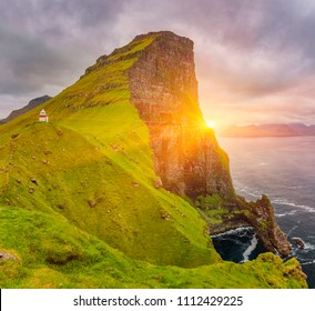 Sunrise over Kalsoy Island and Kallur lighthouse, Faroe Islands, Beautiful Shot Of Nordic Islands