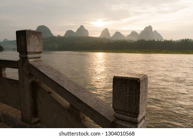 Sunrise over karst mountain and river Li in Yangshuo China landscape