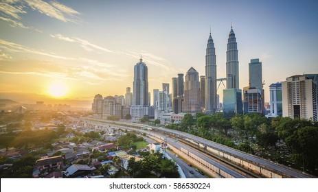 Sunrise over Kuala Lumpur city skyline