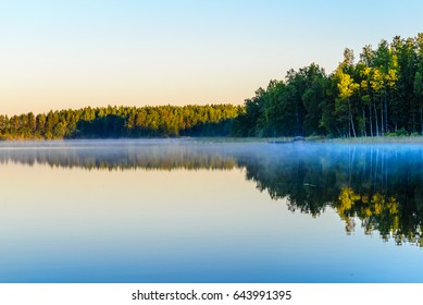 Sunrise over the Lake Haukivesi. Over the water mist. Rantasalmi, Haukivesi lake, Saimaa lake system, Finland.