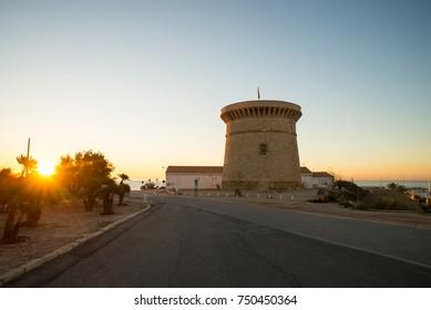 Sunrise over the landmark watchtower in Campello, Costa Blanca, Spain