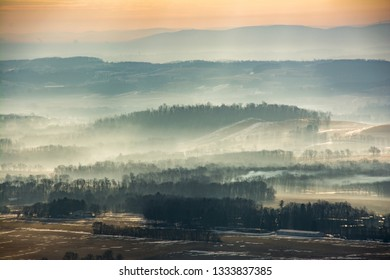 Sunrise over the Lehigh Valley in eastern Pennsylvania as a low fog rolls through the hills.