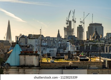 Sunrise over the London skyline with the Shard in the background and cranes over new towers being constructed