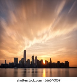 Sunrise over Lower Manhattan, New York City. Sun behind the buildings of the Financial District during early morning.