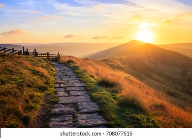 Sunrise over Mam Tor in Peak District on sunny morning in hope valley, Uk.