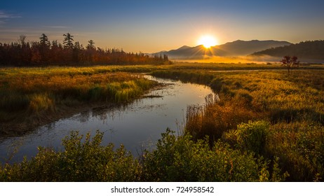 Sunrise over McKenzie Mountain as seen from the Saranac River in Saranac Lake, New York, the Adirondacks