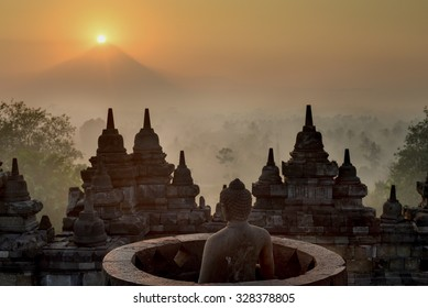 Sunrise over the Merapi volcano at Borobudur Temple