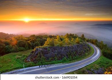 Sunrise over mountain at Doi In Thanon,THAILAND