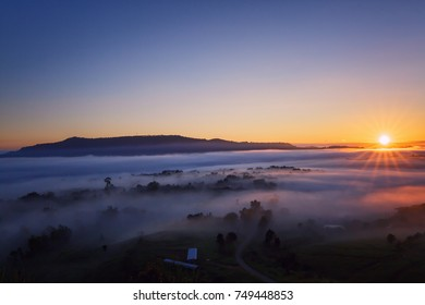 sunrise over mountain and fog landscape at north of Thailand