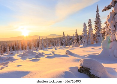 Sunrise over the mountain, forest and snow