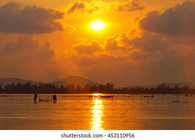 sunrise over mountain with lake on foreground,select focus with shallow depth of field:ideal use for background.