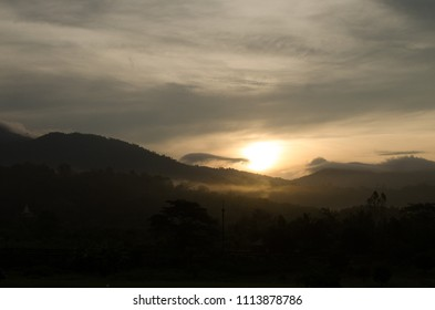 sunrise over the mountain  in the morning at countryside thailand.silhouette photo.