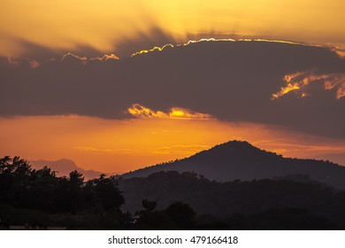Sunrise over the mountain in shade,