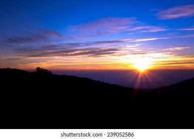 Sunrise over the mountains at Doi Inthanon Chiang Mai, Thailand