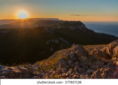 Sunrise over the mountains of the Southern Crimea. View from top of Mount Ilyas Kaya. Laspi Bay.