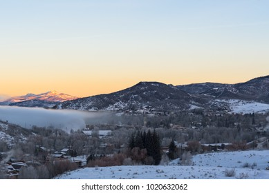 Sunrise over the mountains in Steamboat, morning fog