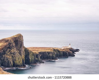 Sunrise over the Neist Point Lighthouse. Popular photographers location on the Isle of Skye in Scotland