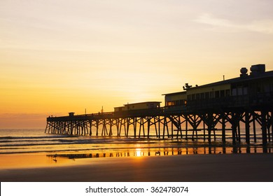 Sunrise over the Ocean. Atlantic Ocean view with a pier in Daytona Beach, Florida.
