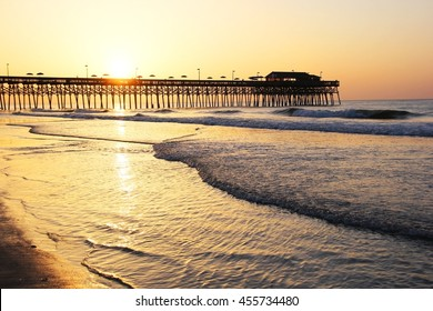 Sunrise over the Ocean. Atlantic Ocean view with a pier in Myrtle Beach aria, South Carolina, USA.