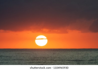 Sunrise over the ocean with orange sky and clouds, Gold Coast, Australia