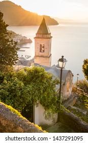 Sunrise over the old catholic church in Amalfi, Italy