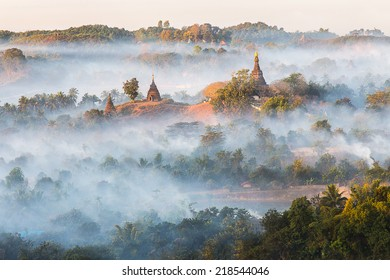 Sunrise over pagodas of  Mrauk U in the mist at the northern Rakhine State, Myanmar