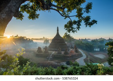 Sunrise over pagodas of Mrauk-U in the mist at the Rakhine State, Myanmar