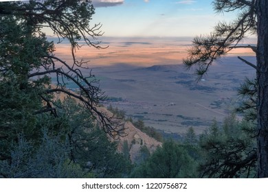Sunrise over the plains from mountain ridge