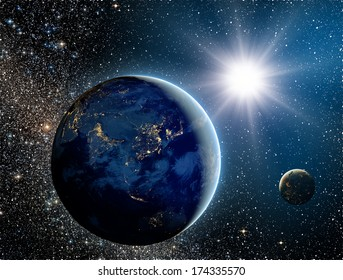 """Sunrise over the planet and satellites in space.""""Elements of this image furnished by NASA"""""""