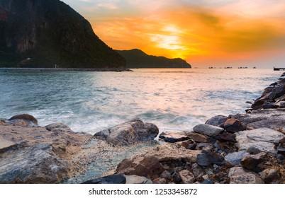 Sunrise over rock beach, natural landscape background