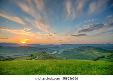 Sunrise over a rolling rural landscape