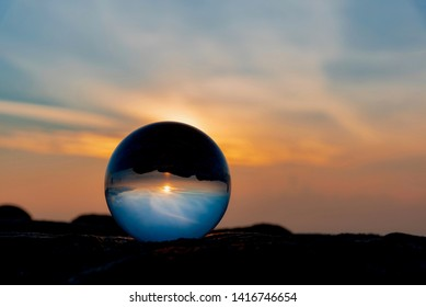 sunrise over the San Francisco Bay in California with a glass sphere
