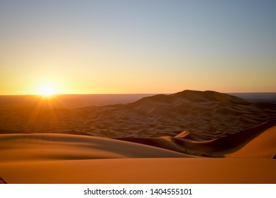 Sunrise over the sand dunes on Sahara Desert Merzouga Morocco