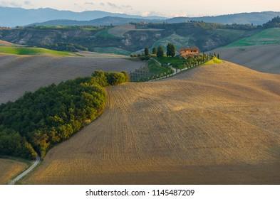 Sunrise over a scenic farm in Tuscany
