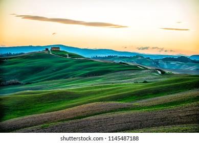 Sunrise over a schenic farm in Tuscany