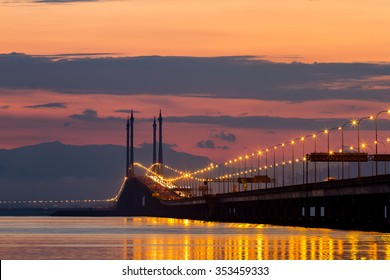 Sunrise over sea and bridge in George Town, Penang, Malaysia