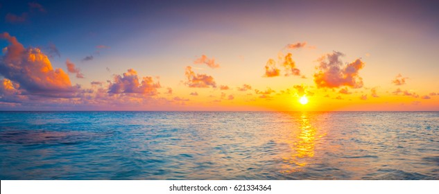 Sunrise over the sea. Panorama web banner or print. Vacation holiday concept background wallpaper.