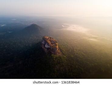 Sunrise over Sigiriya rock fortress in Sri Lanka aerial view