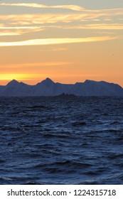 sunrise over snowy mountains, Andenes, Norway, Norwegian Sea, Atlantic Ocean